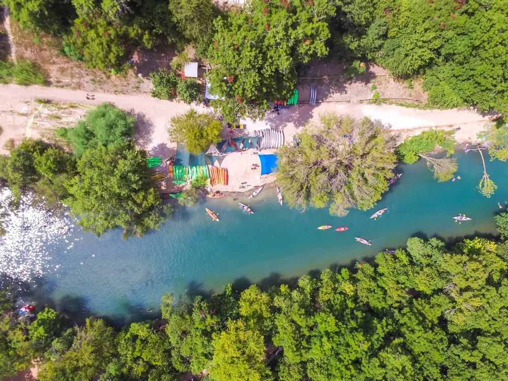 Aerial view of kayaks paddling in Barton Springs, one of the prettiest springs in Texas.