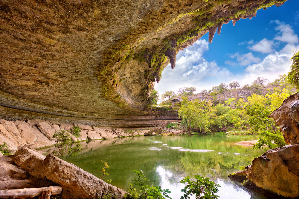 Hamilton Pool is surrounded by pretty trees in the fall.