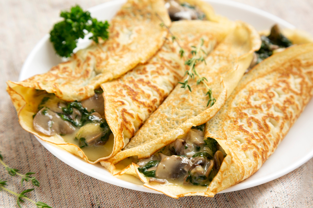 A savory mushroom crepe garnished with thyme leaves. Crepeccino, one of the restaurants in San Antonio, has tasty crepes like this one