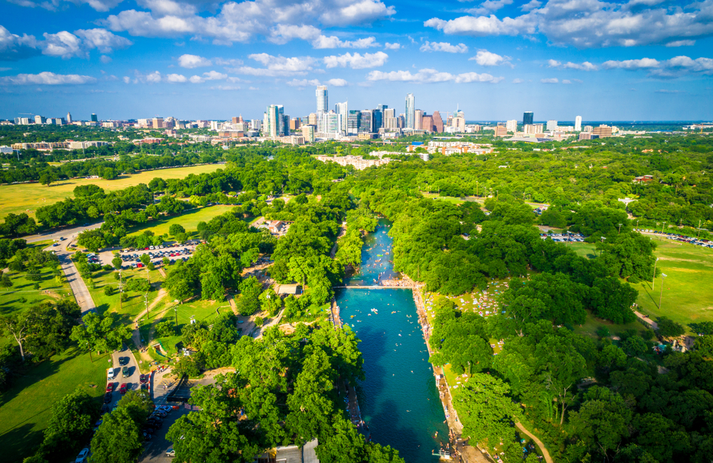 above view of Barton Springs Municipal Pool with downtown austin in the background