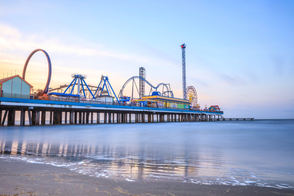 Pleasure Pier in Texas with roller coasters, Ferris wheel and other rides