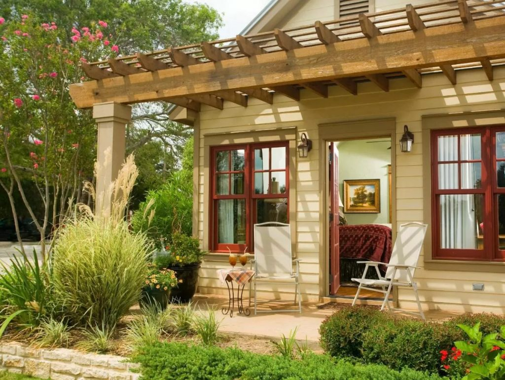 Photo of a guest room with a private porch at the Inn on Lake Granbury, one of the best weekend getaways in Texas.