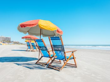 chair and umbrella on one of the best beaches near houston