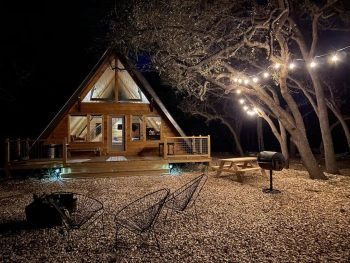 a-frame cabins in texas with fairy lights at night