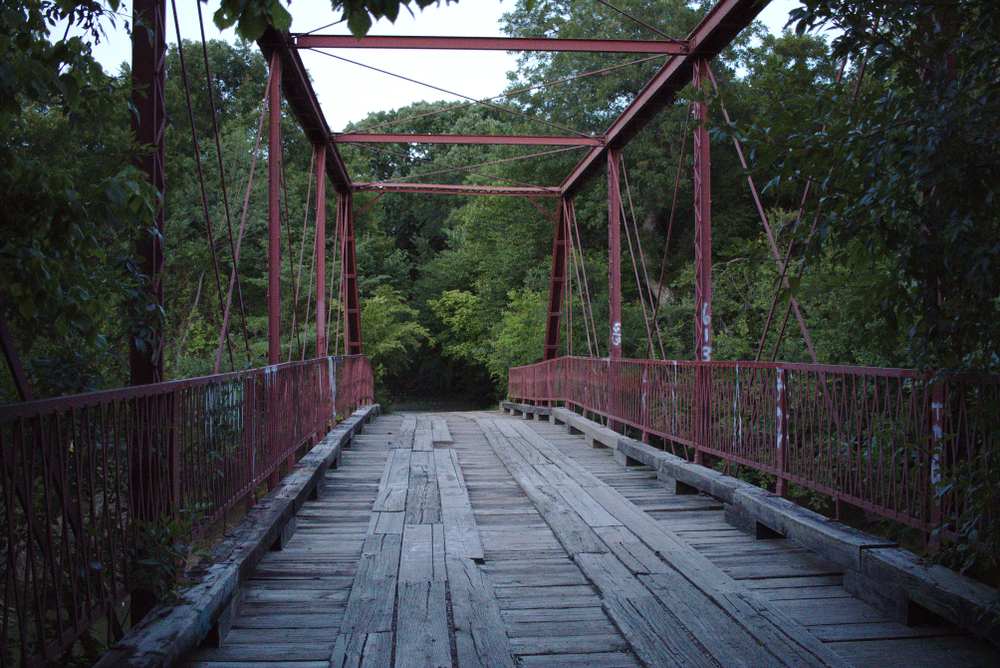 old alton bridge with trees in the background one of the most haunted places in texas