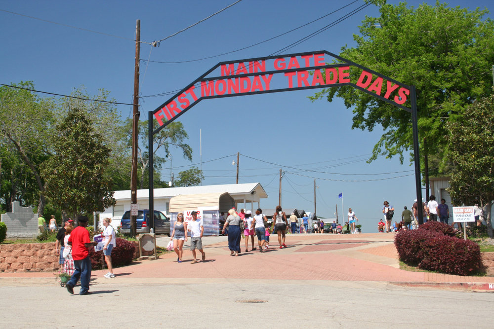 People walking through the main gate for Canton's Trade days flea market.