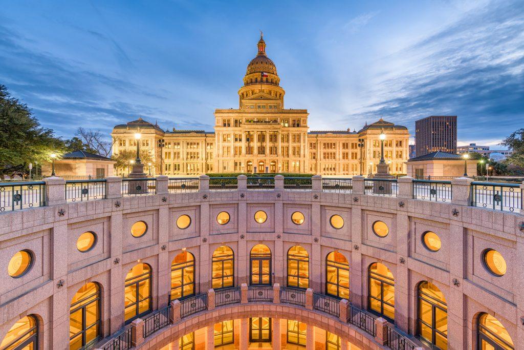 The exterior of the rotunda at Texas'  Capitol building at night