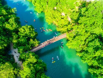people kayaking on a river during their weekend in austin itinerary