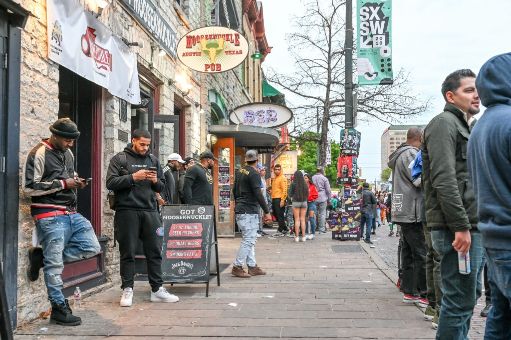 Crowds line the sidewalks on Sixth Street, the center of Austin's entertainment district