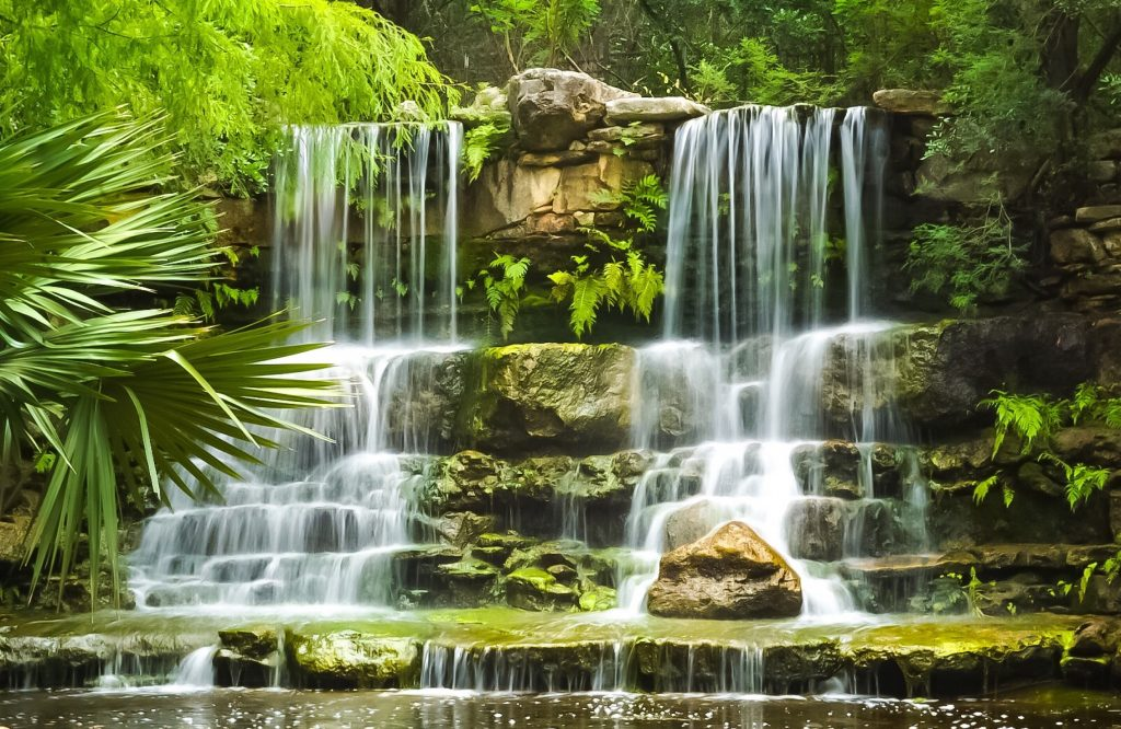 A closeup of a small waterfall cascading over rocks