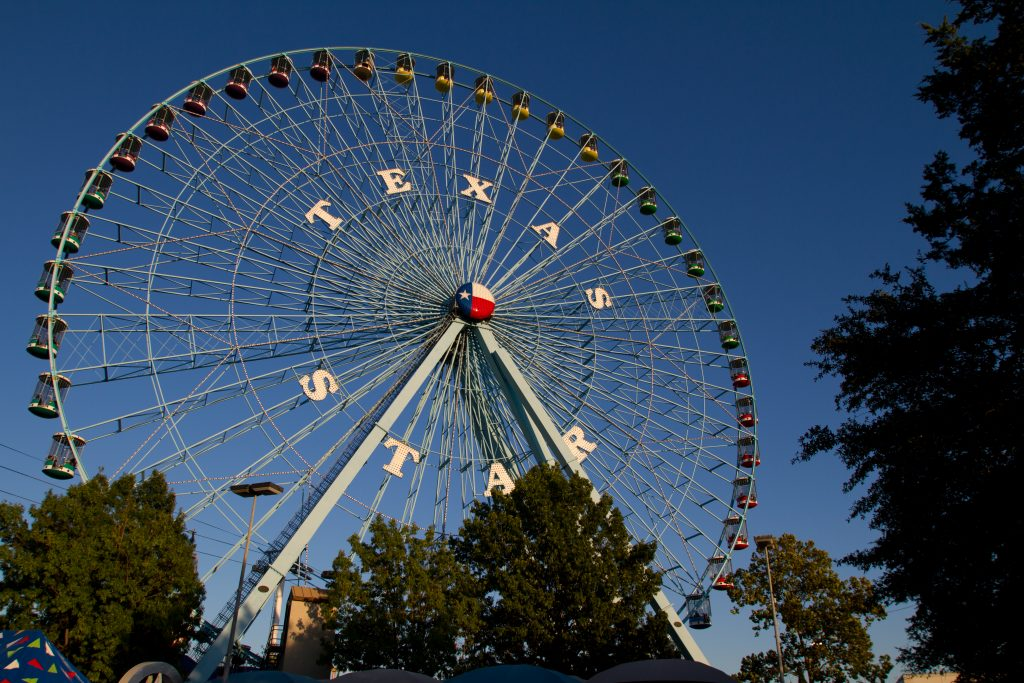 Ferris Wheel labeled with Texas State Fair one of the largest amusement parks in Texas