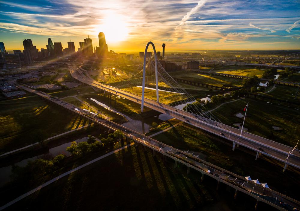 Sunrise over Margaret Hunt Hill Bridge in Dallas time for restaurants to open and serve breakfast in Dallas