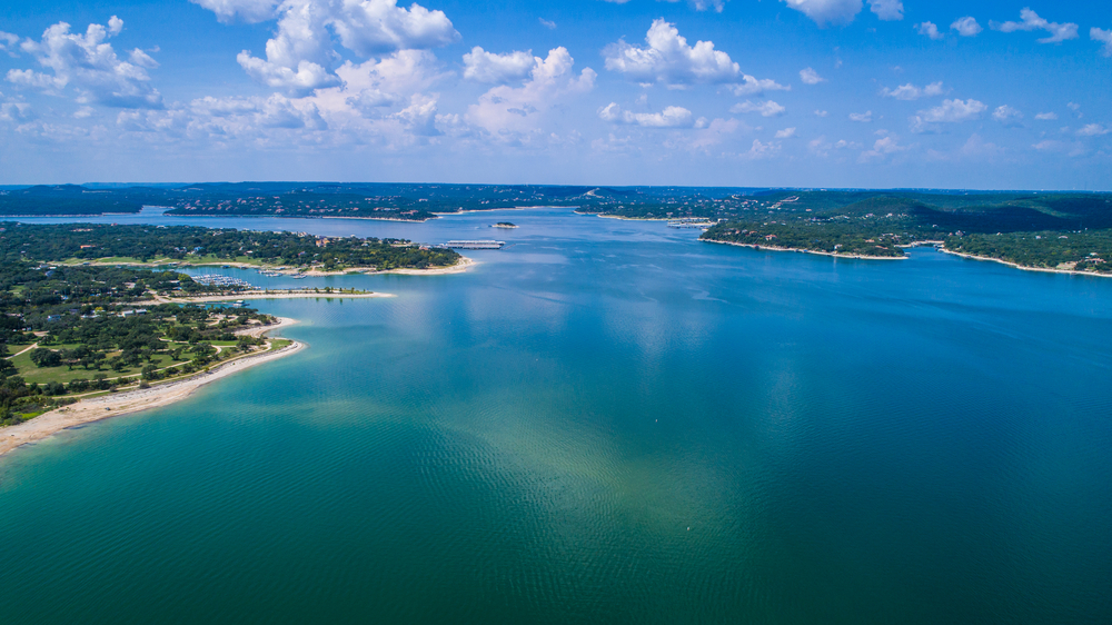 aerial view of blue lake Travis and greenery surrounding it