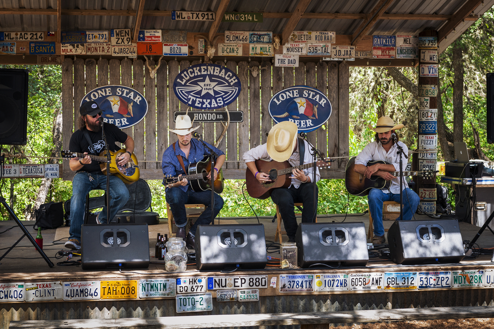 band of four cowboys playing guitars day trips from Austin