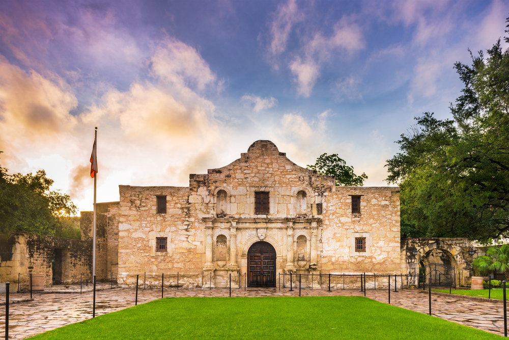 The alamo an old stone structure at sunset one of the most well known museums in texas