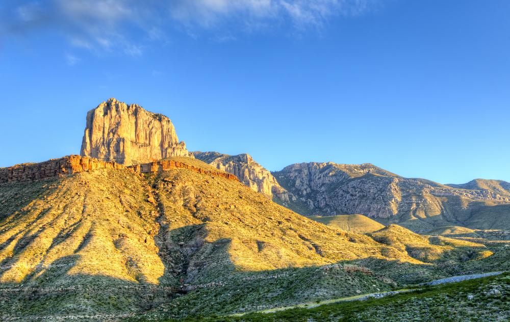 a rocky mountain desert landscape at sunset