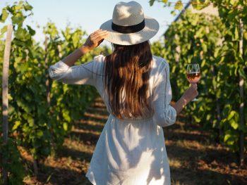 woman walking through one of the best wineries in Fredericksburg