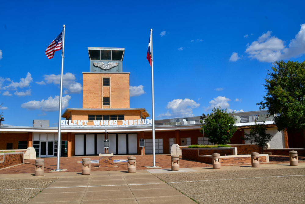 The exterior of the Silent Wings Museum, one of the best things to do in Lubbock. It is a stone building that resembles and old school.