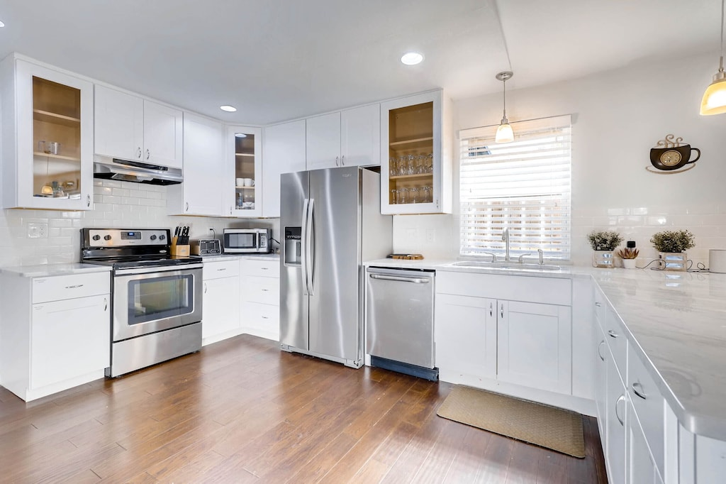 The sleek white kitchen of the Relaxing Retreat. It is so spacious and looks like it would be a dream to cook in!