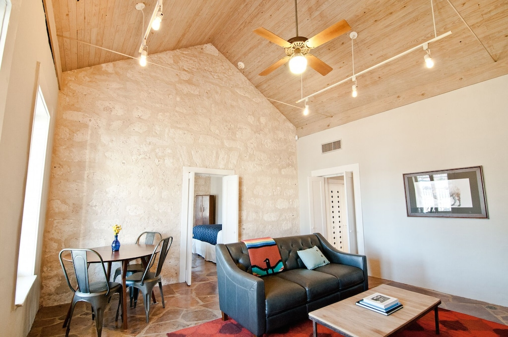 The original 1858 limestone walled living room of the Historic Cottage.