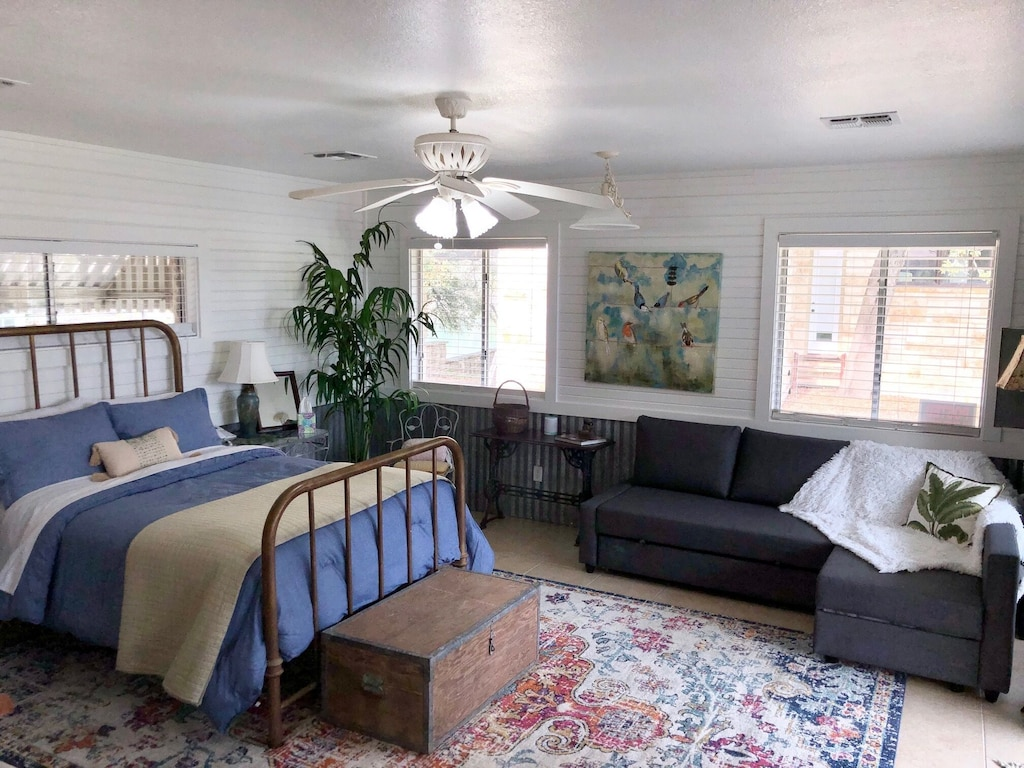 the interior of one of the best cabins in Texas Hill Country with a bed and couch