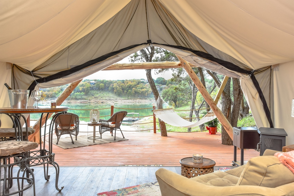 a luxurious tent looking out at the river