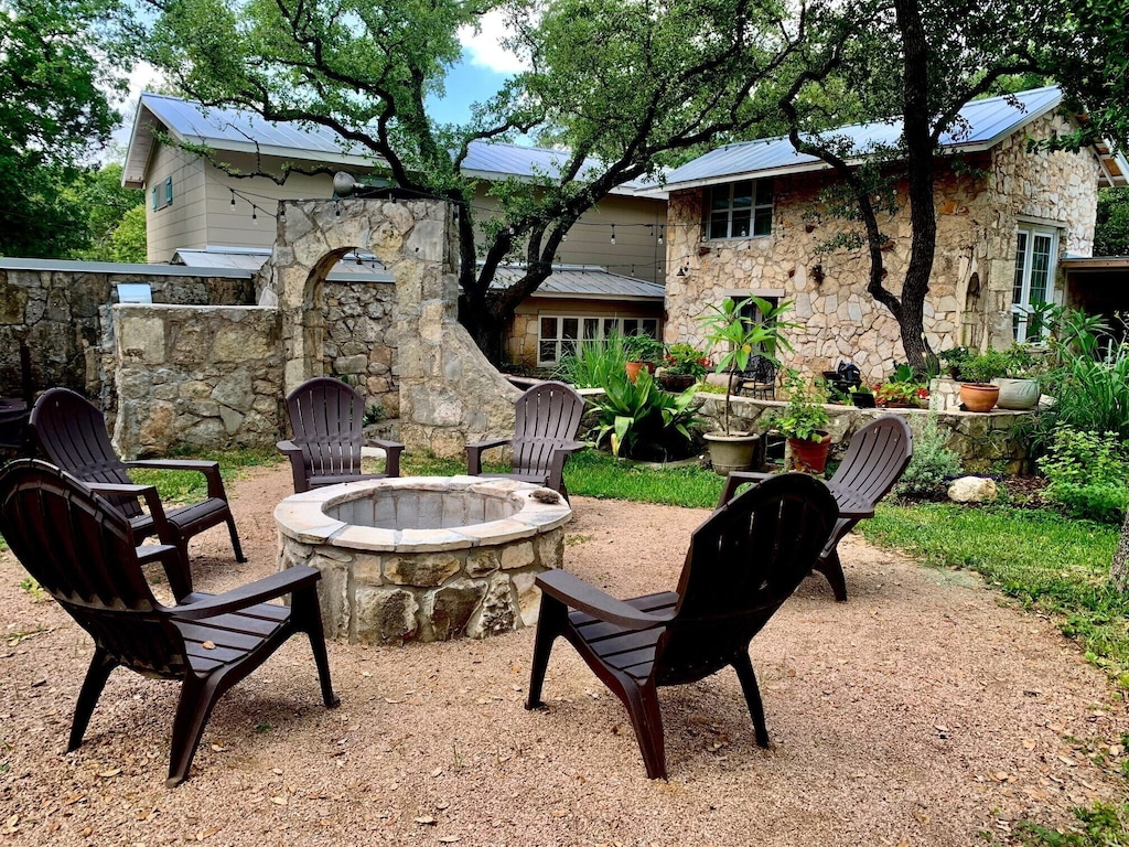 a stone cabin in Texas Hill Country with a fire pit