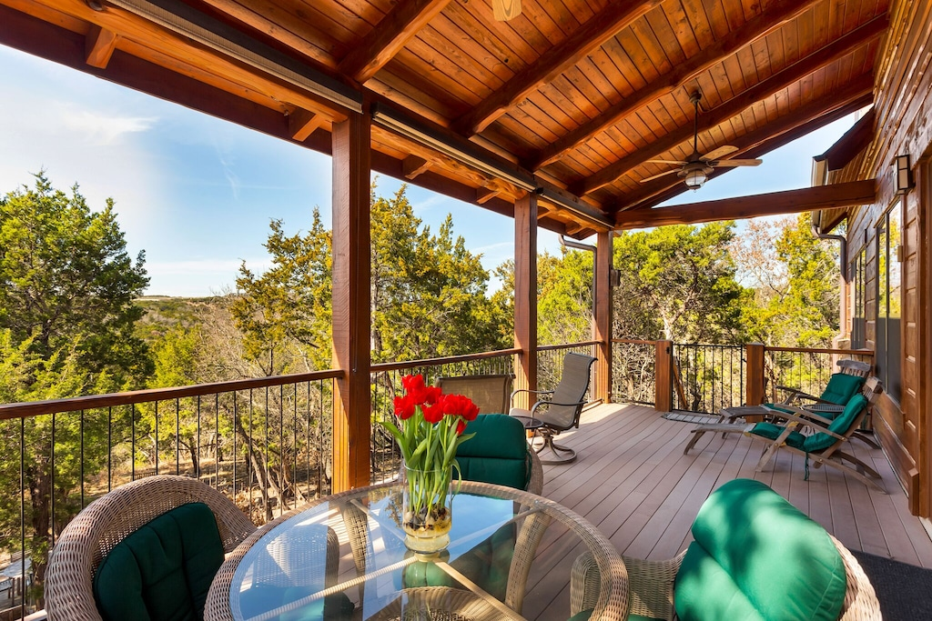 a wood cabin deck with comfy chairs
