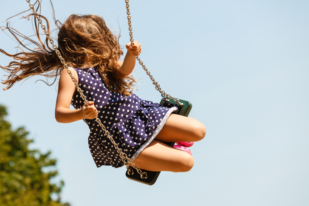 girl swinging in MacArthur Park!